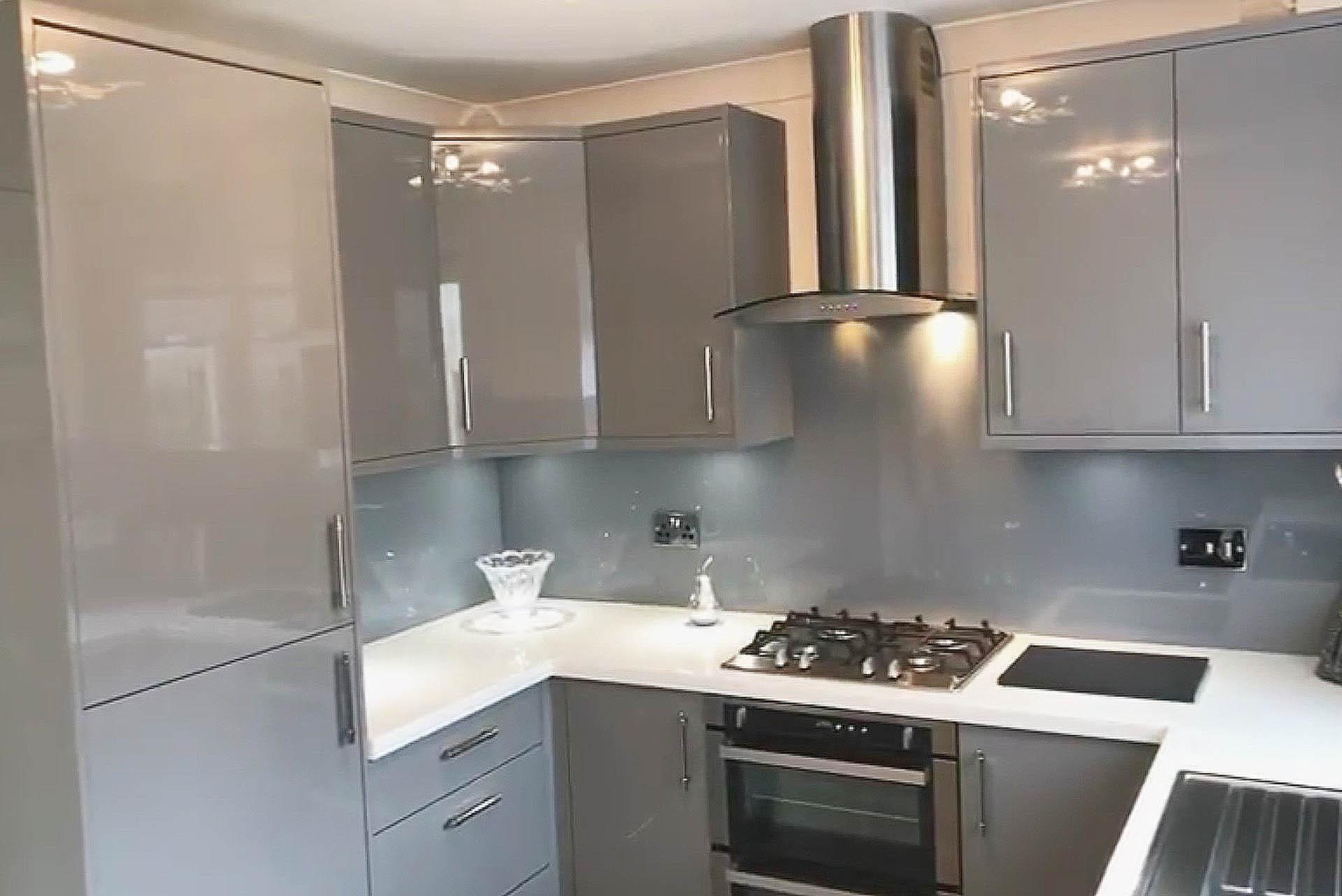 Zola Dust Grey Gloss Slab Kitchen - Grey fitted kitchens